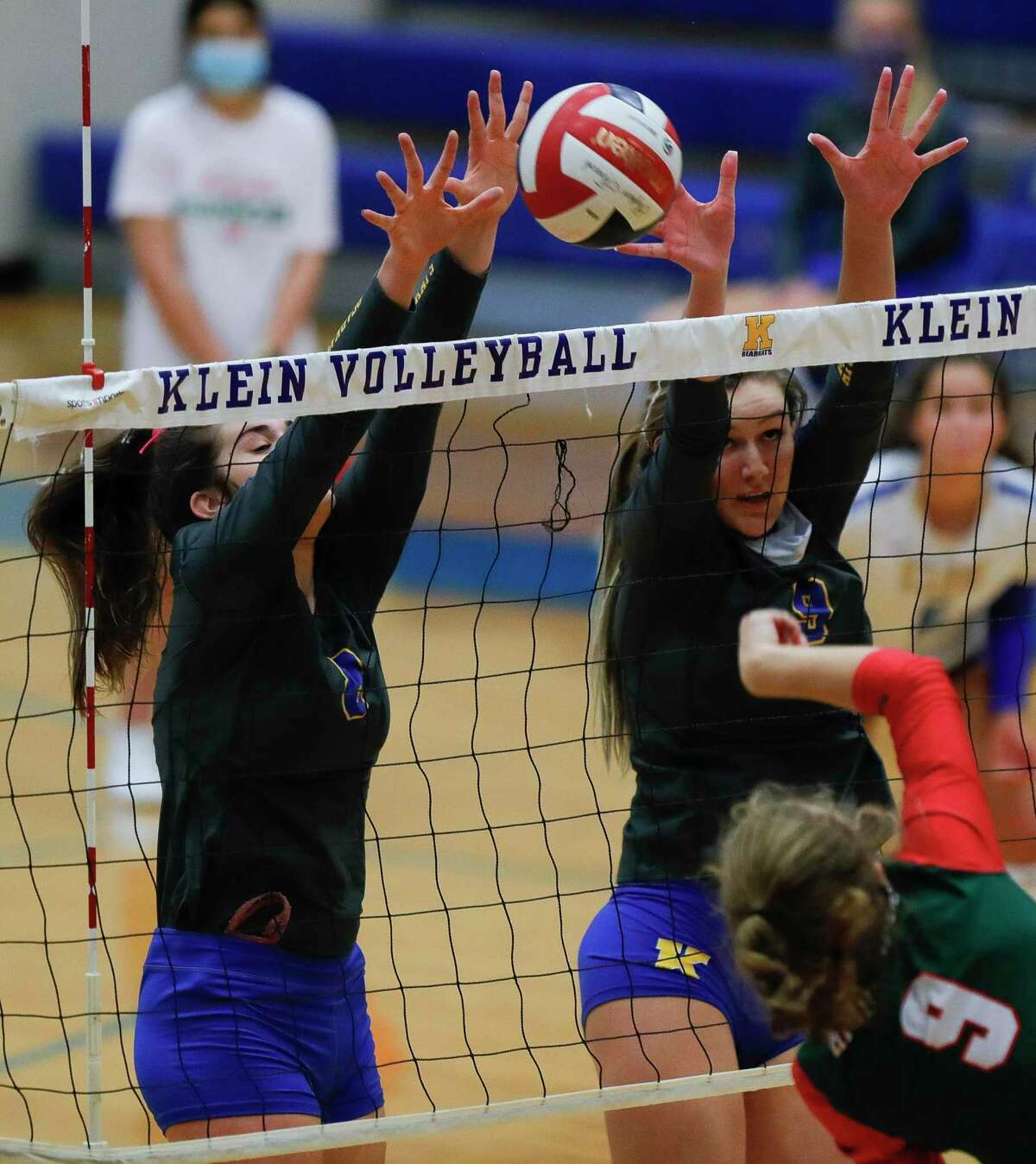 Klein middle hitter Kierstyn Mcfall (9) blocks a shot by The Woodlands outside hitter Makenzie Weddel (9) beside Klein right side hitter Abby Sweeney (8) during the second set of a non-district high school volleyball match at Klein High School, Saturday, Oct. 10, 2020, in Spring.