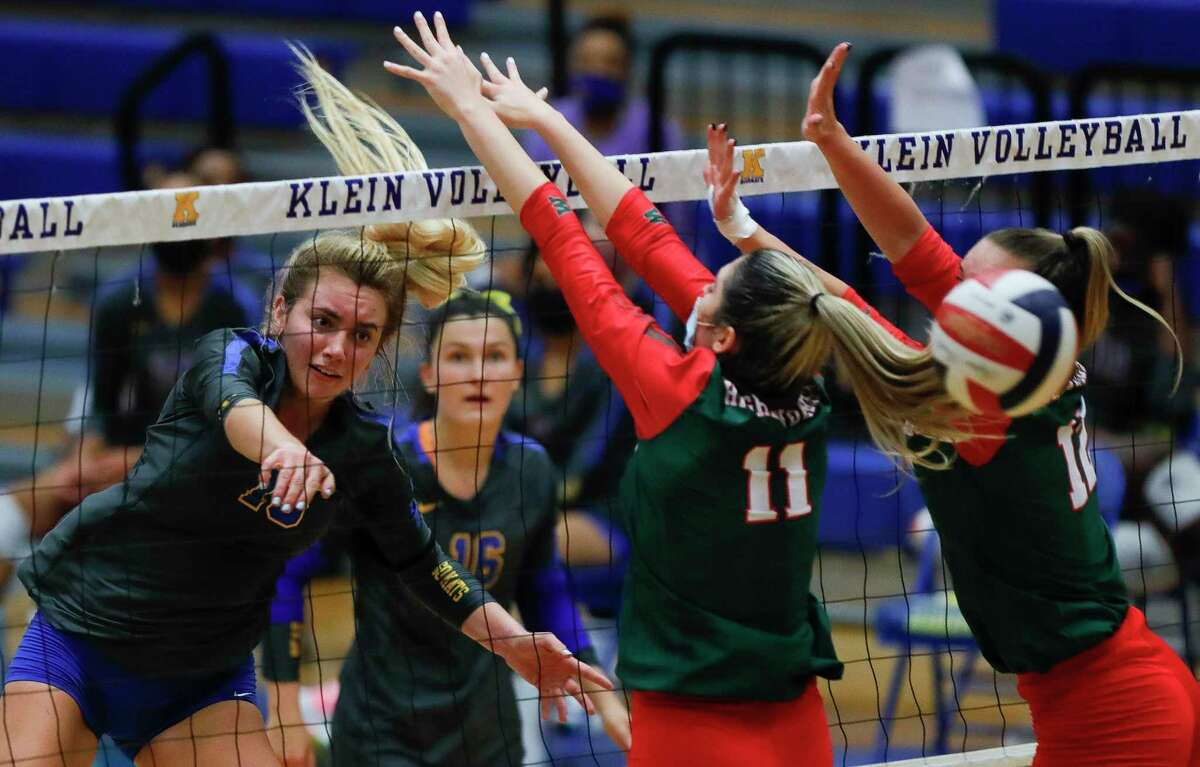 Klein setter hitter Annie Antar (13) gets a shot past The Woodlands outside hitter Natasha Zorbas (11) and setter Clara Brower (13) during the second set of a non-district high school volleyball match at Klein High School, Saturday, Oct. 10, 2020, in Spring.