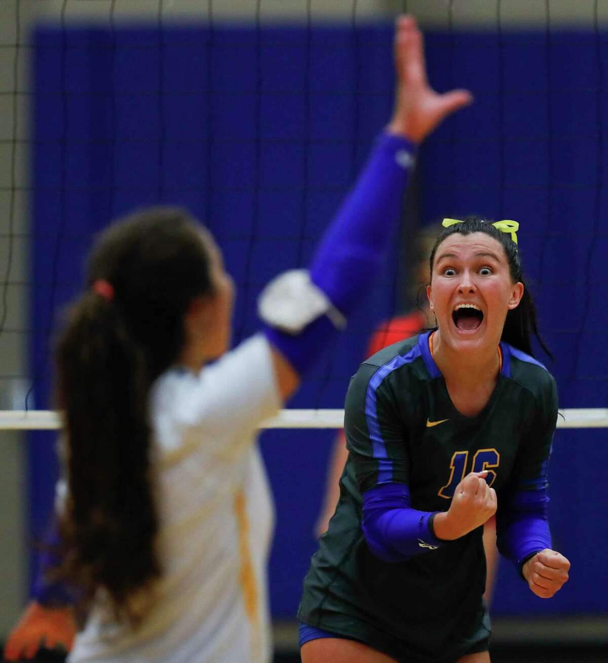 Klein outside hitter Devan Taylor (16) reacts after an ace by libero Gabriela Mansfield (6) during the second set of a non-district high school volleyball match at Klein High School, Saturday, Oct. 10, 2020, in Spring.