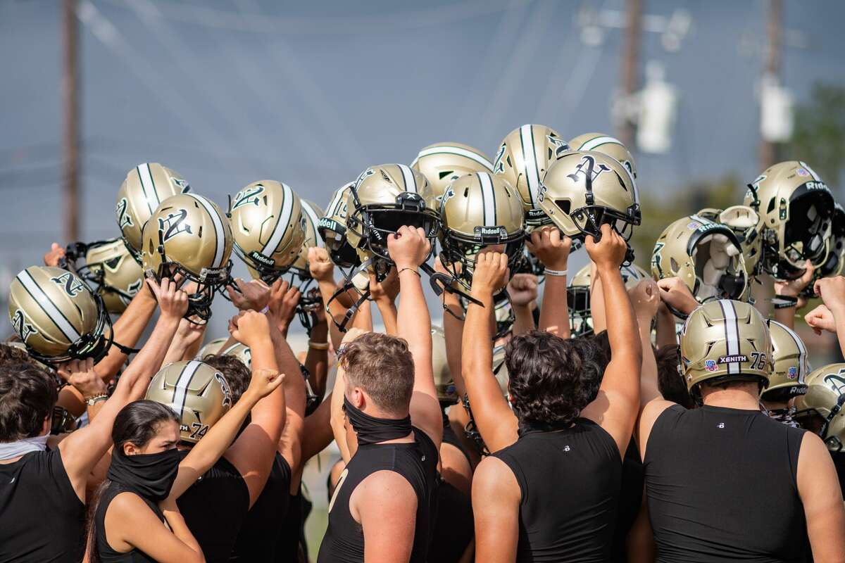 The Bulldogs come together to celebrate as a team at the end of practice. The Nederland Bulldogs practice on Thursday for their game with Port Neches-Groves on Friday night for Mid County Madness. Photo made on October 22, 2020. Fran Ruchalski/The Enterprise