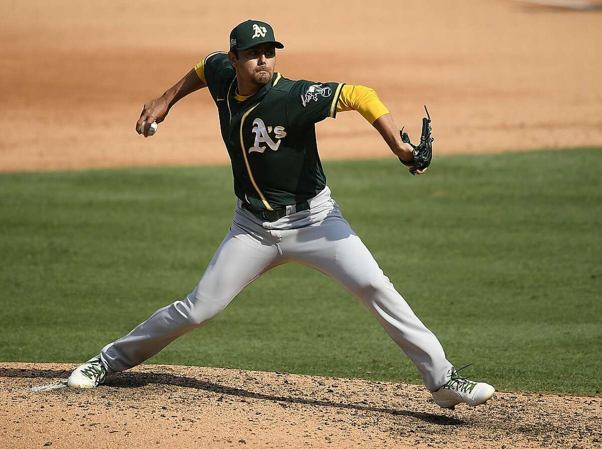 LOS ANGELES, CALIFORNIA - OCTOBER 08: Joakim Soria #48 of the Oakland Athletics throws against the Houston Astros during the sixth inning in Game Four of the American League Division Series at Dodger Stadium on October 08, 2020 in Los Angeles, California. (Photo by Kevork Djansezian/Getty Images)
