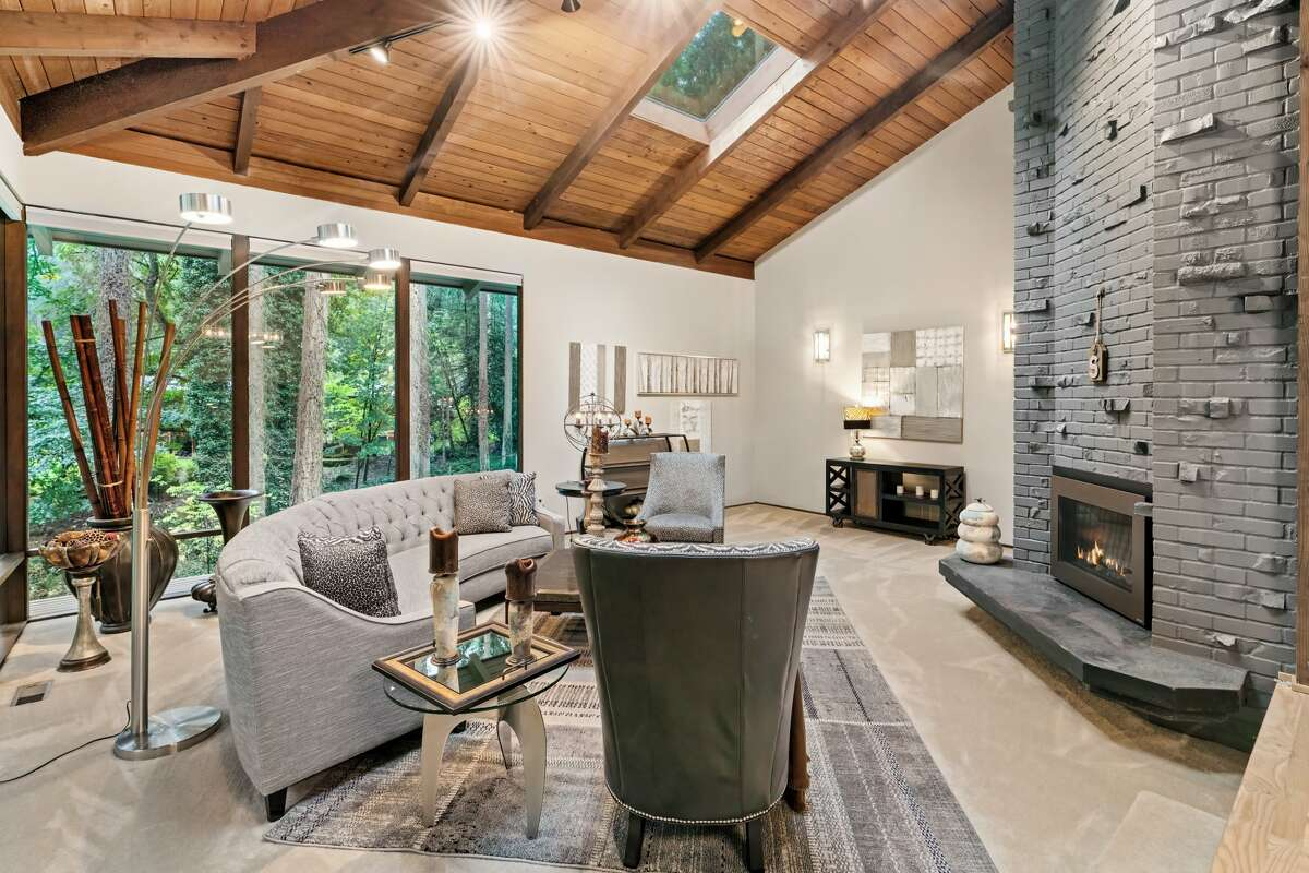 Inside, the home features 12-foot ceilings in the living room - a light and open space anchored by this tremendous hearth.