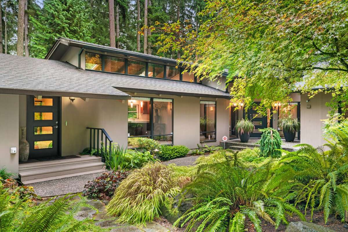 The home is 2,700 square feet, nestled on an impressively landscaped .81 acre lot.