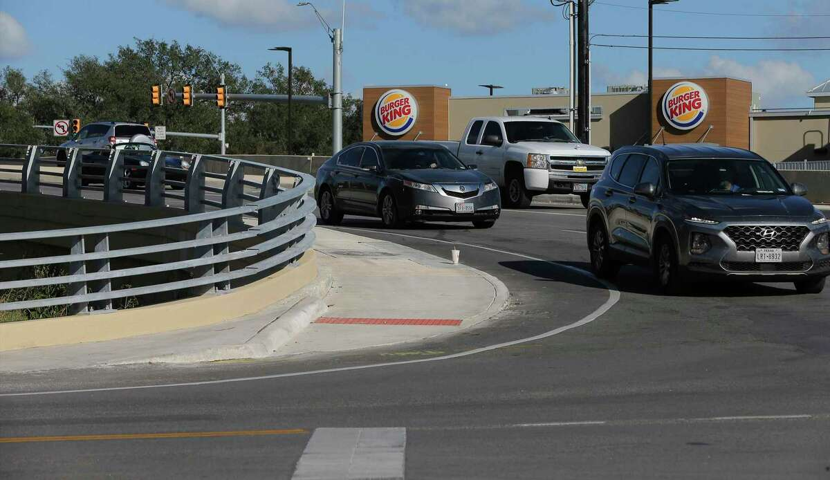 Motorists make their way around the intersection of FM 1560 and and Riggs Road in Helotes on Wednesday, Oct. 21, 2020. Concerned Helotes residents, COPS/METRO and elected officials worked together and persuaded the Texas Department of Transportation to remove a cement wall that created a dangerous intersection and have landscaped the area making it safer and better-looking.