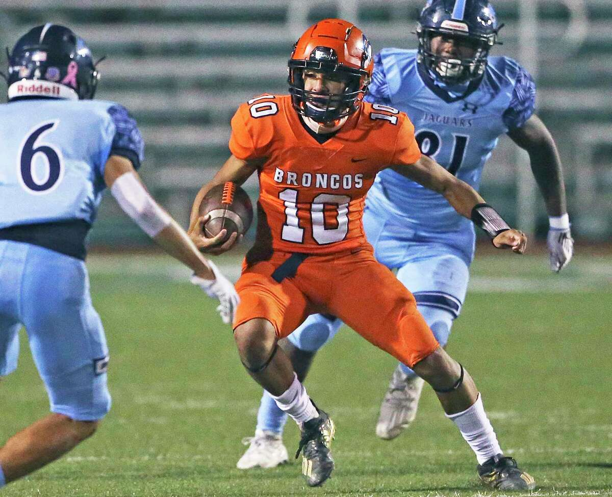Bronco quarterback Nico Garcia runs in the open field as Brandeis hosts Johnson at Farris Stadium on Oct.22, 2020.