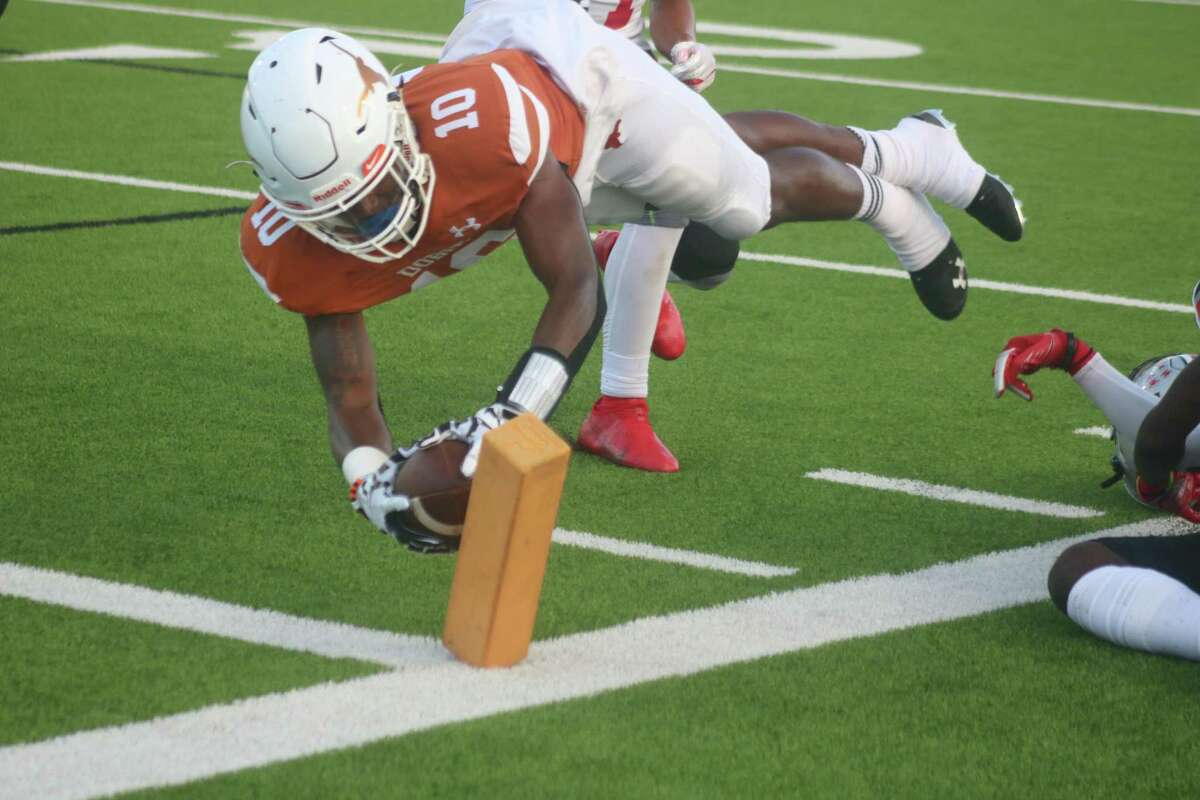 Dobie's Johnathan Baldwin successfully dives for the end zone, scoring the first of his five TDs Thursday night.