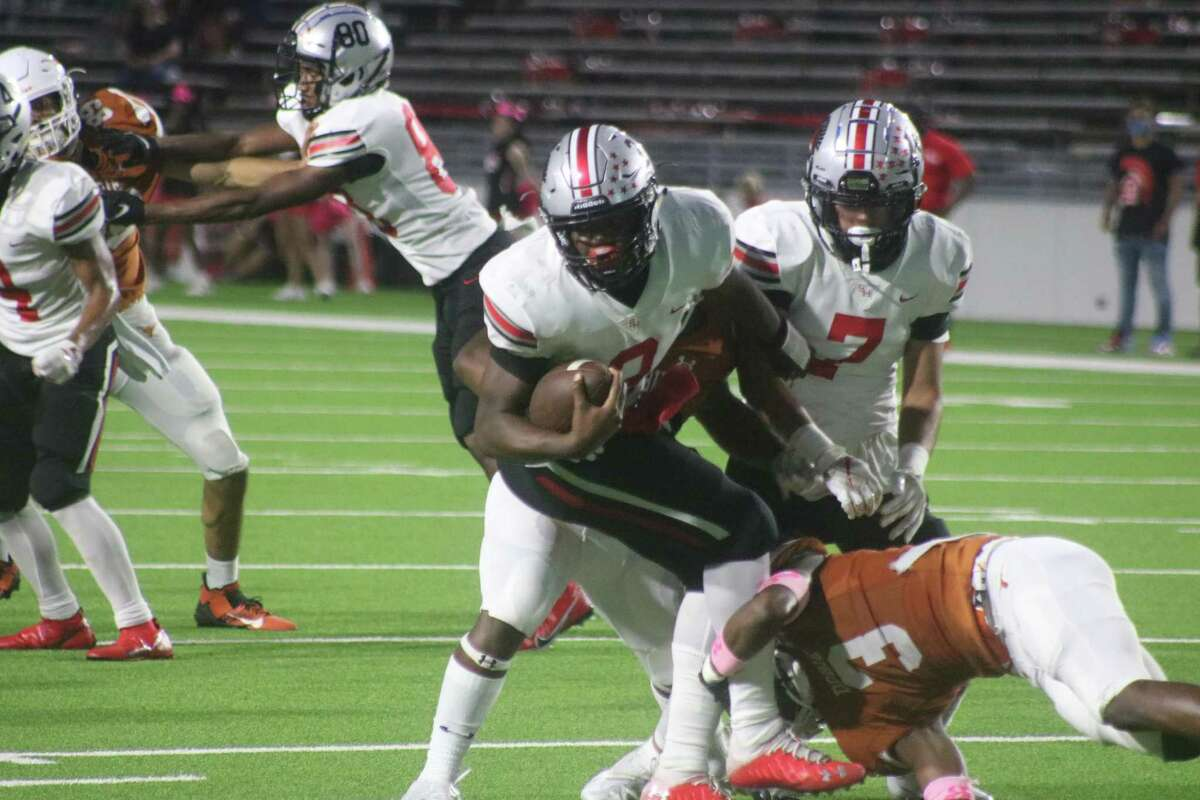 South Houston quarterback Kam'ron Webb is stopped by Dobie's Keion Thompson (3) and another Longhorn during first-half play Thursday night. Webb still rushed for over 100 yards in the game.
