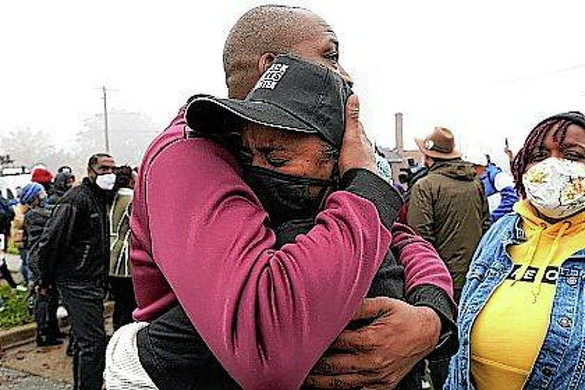 Marcellis Stinnette's grandmother, Sherrellis Stinnette (right) cries Thursday as she hugs Rayon Edwards during a protest rally for Marcellis Stinnette, 19, who killed Tuesday by Waukegan police in Waukegan.