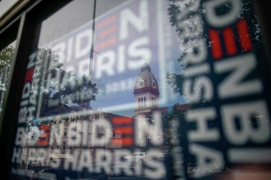 A window of Joe Biden campaign signs is seen at an office distributing yard signs in Easton, Pa., on Oct.10, 2020 Photo: Photo For The Washington Post By Mark Makela / Mark Makela