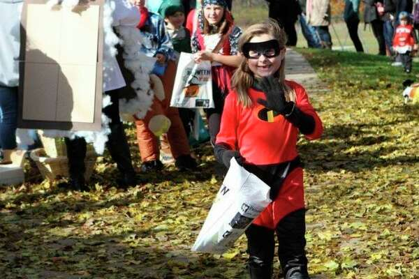 Kids and parents are encouraged to wear face masks and be cautious as they go trick-or-treating this year. (Pioneer file photo)