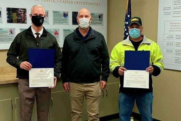Congressman John Moolenaar, center, presented Gladwin County Sheriff Mike Shea, left, and Marty Govitz certificates of special congressional recognition for their actions to protect residents during the flooding. He presented the awards Tuesday at the Beaverton Activity Center. (Photo Provided)