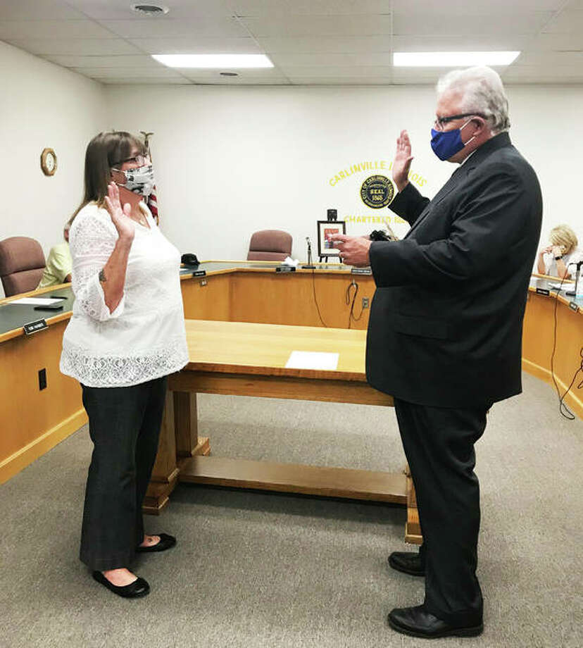 City attorney Dan O'Brien swears in Alderman Sarah Oswald, 68, as mayor to fulfill the remaining term of former mayor, the late Deanna Demuzio, who died Tuesday. Photo: Jill Moon|The Telegraph