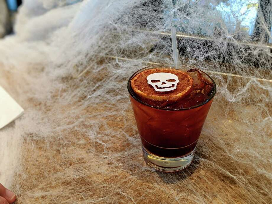 Brennan's of Houston is celebrating Halloween with a Booze & Boos promotion that includes theme cocktails such as Haunted Graveyard. Photo: Brennan's Of Houston