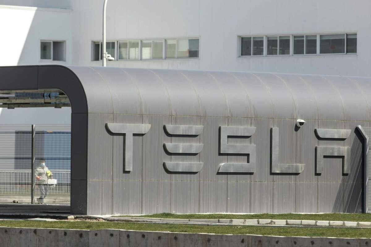 A worker walks through the Tesla Gigafactory in Shanghai, China, on Feb. 17, 2020.