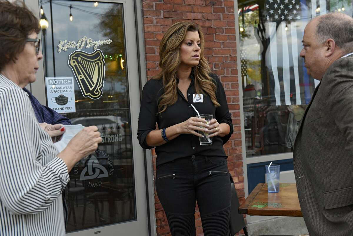 Liz Joy, center, candidate for New York's 20th Congressional District, is seen talking to supporters at a meet and greet at Katie O'Byrnes Restaurant on Wednesday, Oct. 21, 2020 in Schenectady, N.Y. Joy is running against Congressman Paul Tonko. (Lori Van Buren/Times Union)