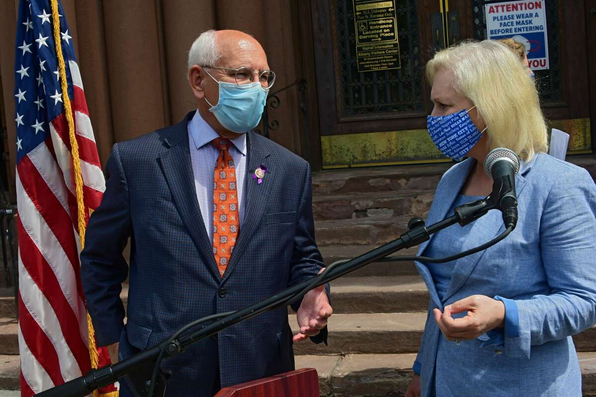 U.S. Representative Paul Tonko speaks with U.S. Senator Kirsten Gillibrand after they stood at Albany City Hall to call for legislation to provide local governments with direct federal relief that can be used to pay for essential services, offset lost revenues and increased costs from the COVID-19 emergency on Thursday, Aug. 6, 2020 in Albany, N.Y. (Lori Van Buren/Times Union)