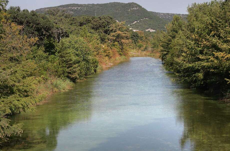 The crystal clear waters of the Sabinal River is framed by shimmering fall leaves where Texas Farm Road 337 crosses the river near Texas Farm Road 187, on Tuesday, Oct. 6, 2020. Photo: Bob Owen, Staff-photographer / San Antonio Express-News / ©2020 San Antonio Express-News