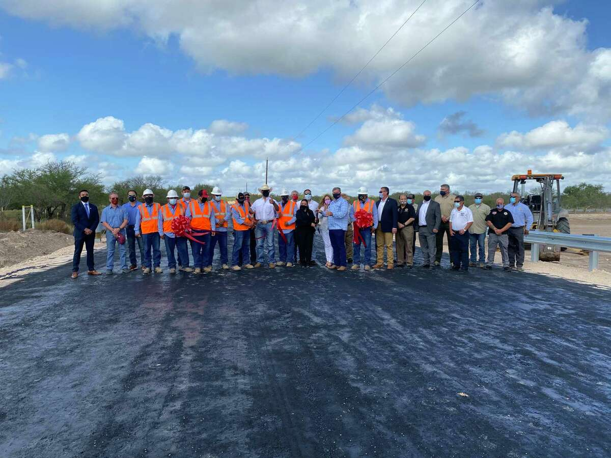 A ribbon cutting was held to celebrate the completion of two drainage canals by the Webb County Road and Bridge Department.