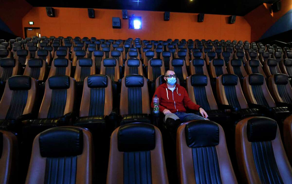 Joshua Caisse of Schenectady waits for the movie