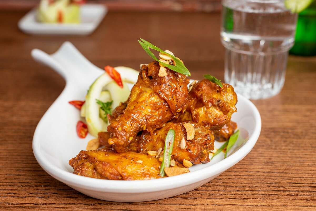 Burma Bites' mohinga wings are tossed in a wok and coated with the same lemongrass, ginger and tumeric flavors that can be found in Burma Superstar's traditional mohinga noodle dish, which usually features fish.