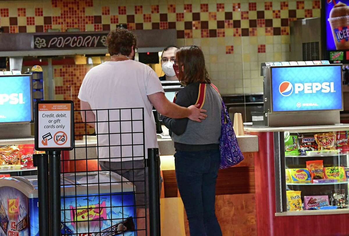 Movie goers are seen getting snacks at the concessions counter at Regal Cinemas at Colonie Center on Friday, Oct. 23, 2020 in Colonie, N.Y. The movie fans are returning to the theaters for the first time since the pandemic started. (Lori Van Buren/Times Union)