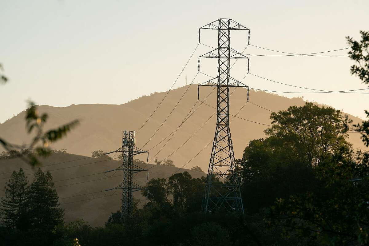 Power lines are seen during sunrise at Sugarloaf Open Space in Walnut Creek on Friday. PG&E is expected to turn off the power to some Bay Area homes starting Sunday as extreme fire weather arrives.