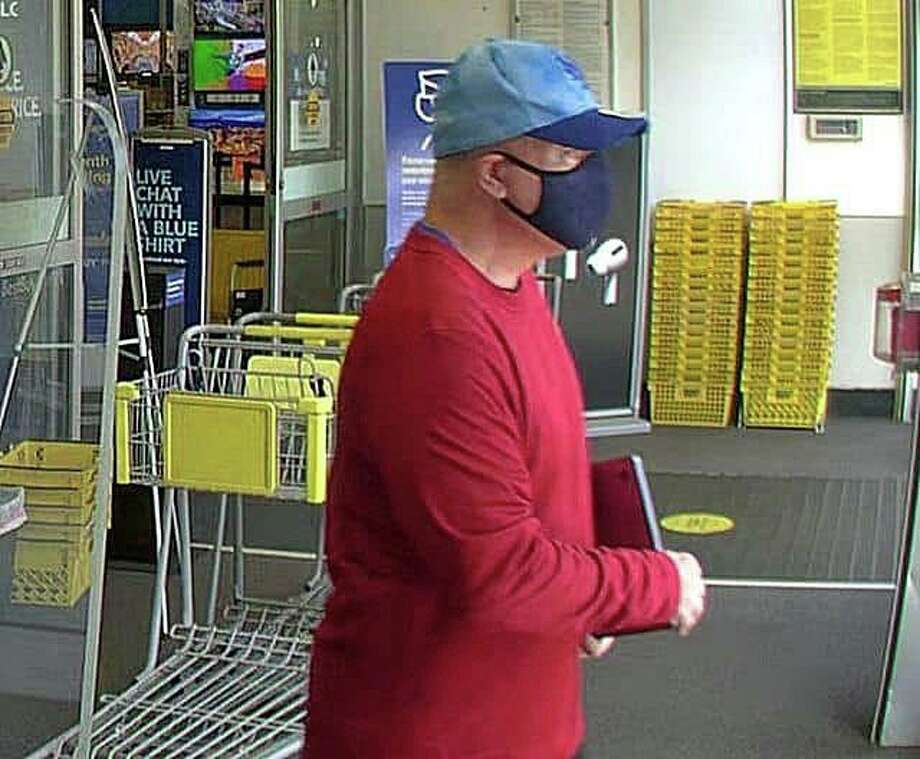 Waterford police believe this man, suspected of stealing electronic items, has some type of device that unlocks the display items from shelves at the town's Best Buy store. The man stole the items from the same store on Hartford Turnpike on two different days this month, police said. Photo: Waterford Police Photo