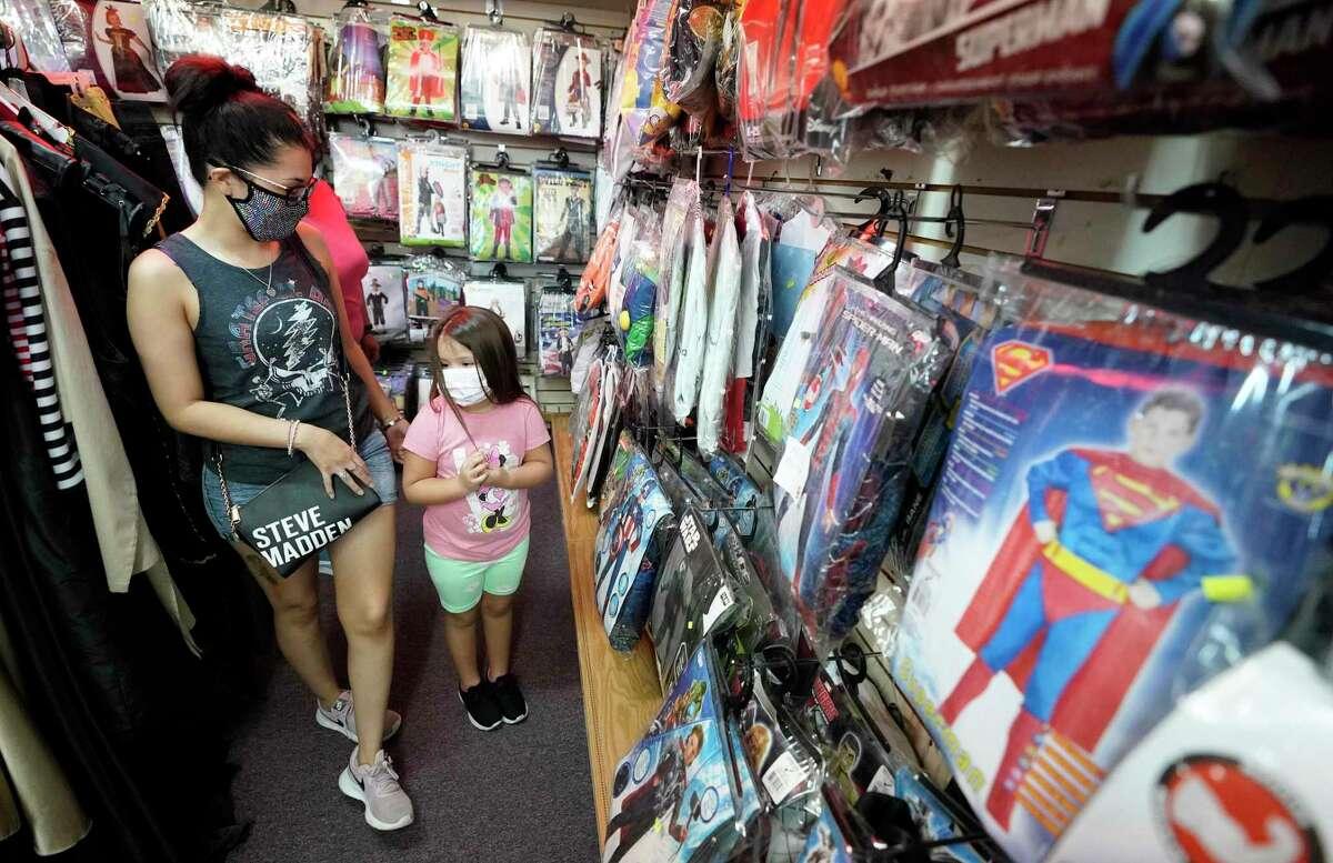 Jenaya Perez, 5, looks at Halloween costumes with her mother, Miranda Salinas, at Joe Sam's Fun Shop, 1612 East Southmore Ave., Thursday, Oct. 22, 2020 in Pasadena.