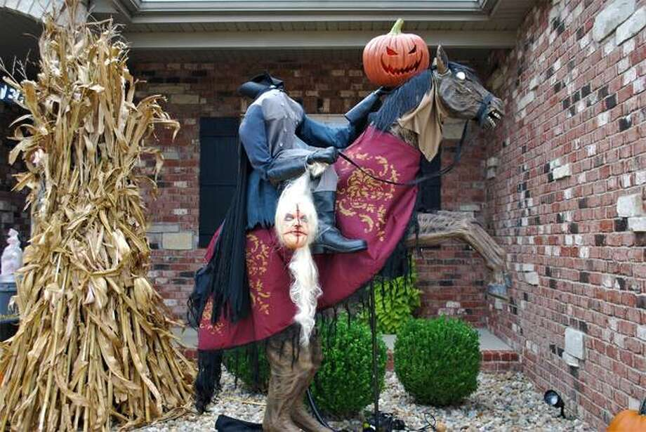 The Garde house is decorated for Halloween with a Headless Horseman theme this year.