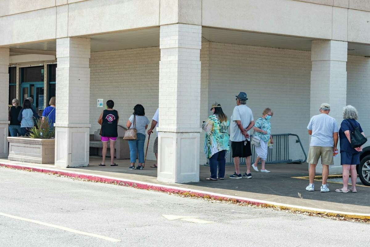 There were lines outside the Marion and Ed Hughes Public Library in Nederland most of the day, but folks said they only waited a few minutes in line. Tuesday was the first day of early voting in Texas and manypeople came out to do their civic duty throughout Jefferson County. Photo made on October 12, 2020. Fran Ruchalski/The Enterprise