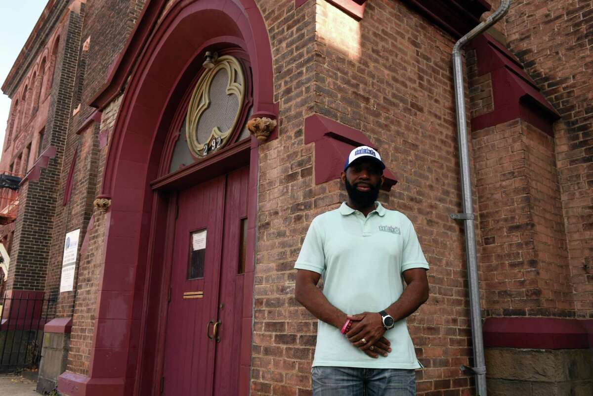 Jerry Ford is pictured outside the United Ordained Church on Third Street where he serves as a deacon on Friday, Oct. 23, 2020, in Troy, N.Y. The community leader is working on the Souls to the Polls effort to get downtown Troy minority and other residents without cars out to early voting sites that are not easily accessible in Troy and Brunswick. (Will Waldron/Times Union)
