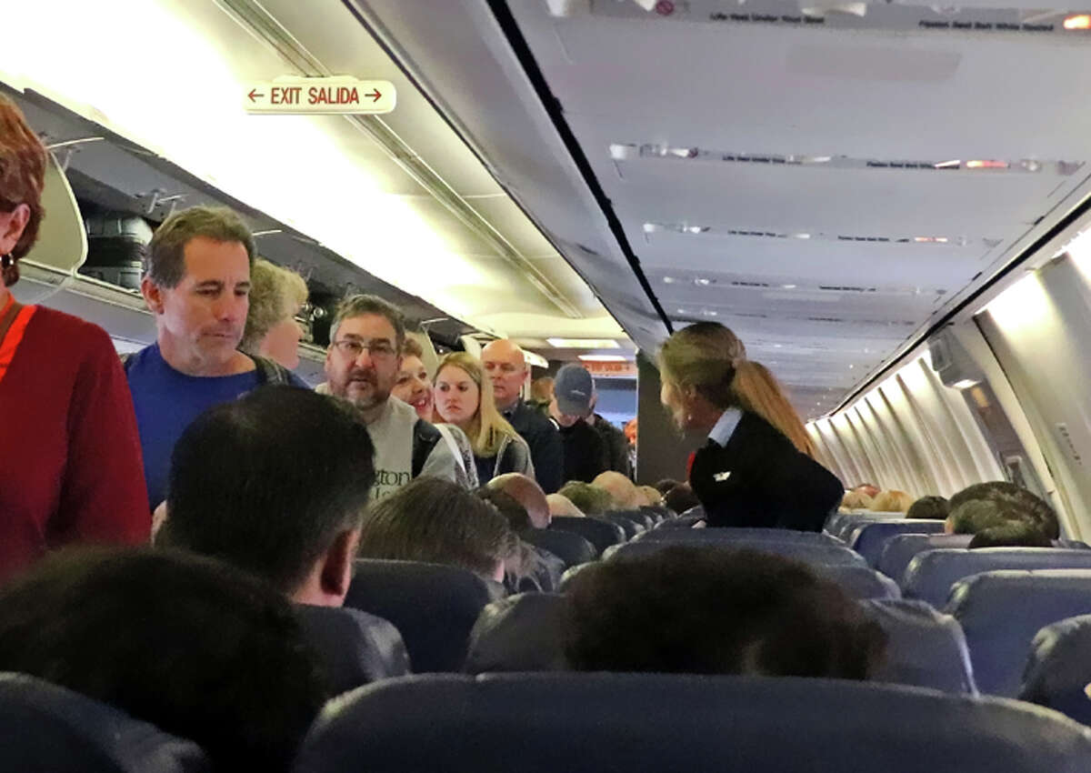 Southwest will stop blocking out middle seats in December.