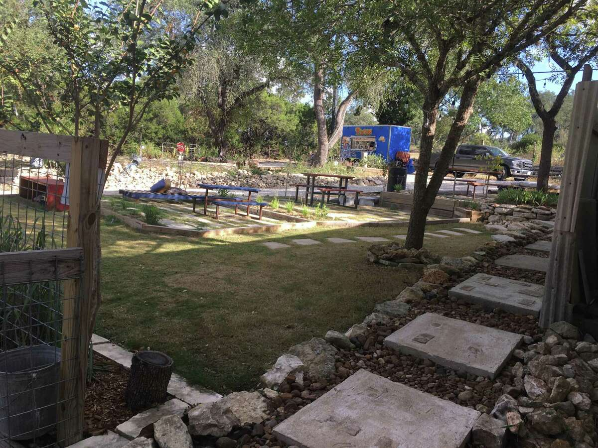 There are plentiful outdoor seating areas at The Divide, a new bar and food truck park on San Antonio's Northwest Side.