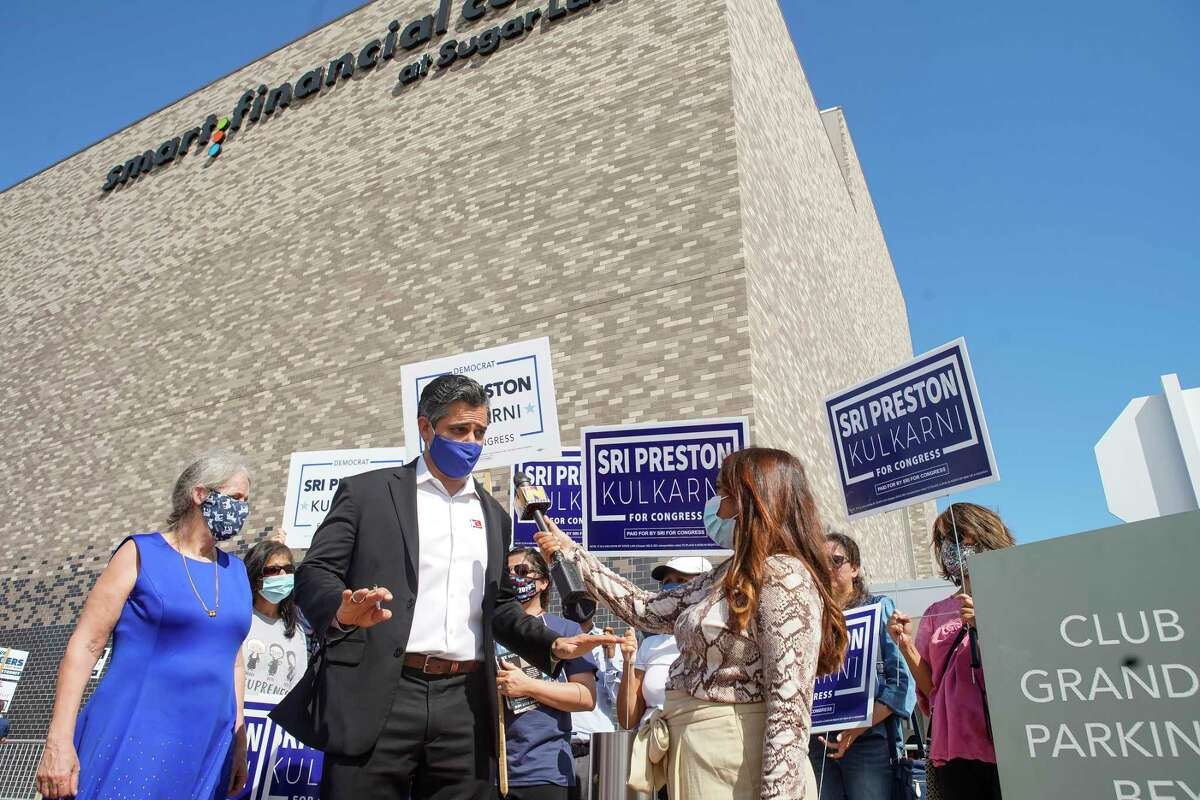 Democratic congressional candidate Sri Preston Kulkarni speaks with members of the media outside the early voting site after voting at the Smart Financial Center, Wednesday, Oct. 21, 2020, in Sugar Land.