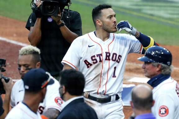 Houston Astros Carlos Correa celebrates with his teammates after hitting a walk off home run off Tampa Bay Rays reliever Nick Anderson to win Game 5 of the American League Championship Series 4-3 at Petco Park Thursday, Oct. 15, 2020, in San Diego.