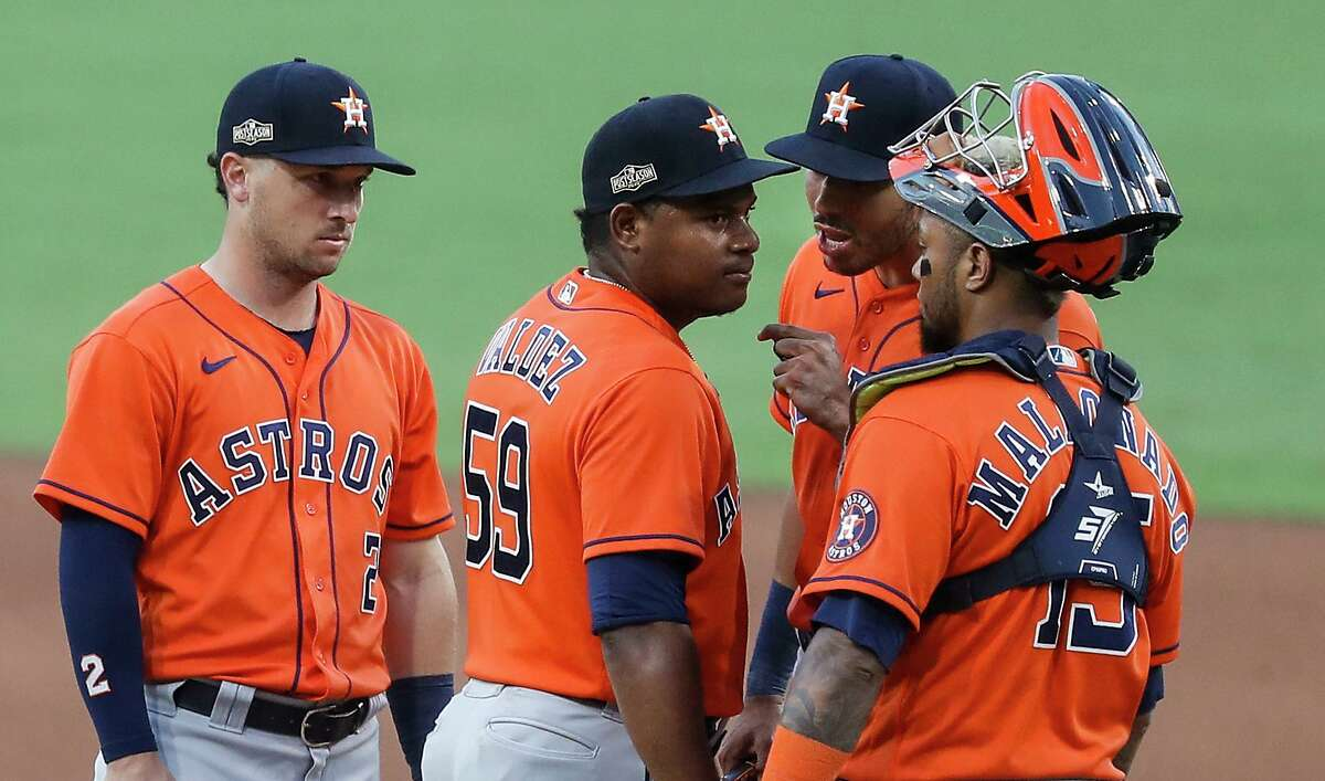 Carlos Correa talks to Framber Valdez in Game 6 of the ALCS after an incident with Yandy Diaz.
