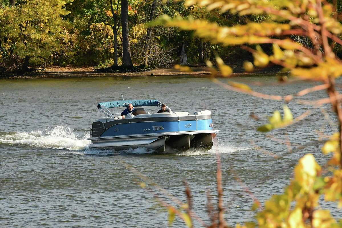 A couple men are seen in a pontoon near the Corning Preserve boat launch on Friday, Oct. 23, 2020 in Albany, N.Y. (Lori Van Buren/Times Union)