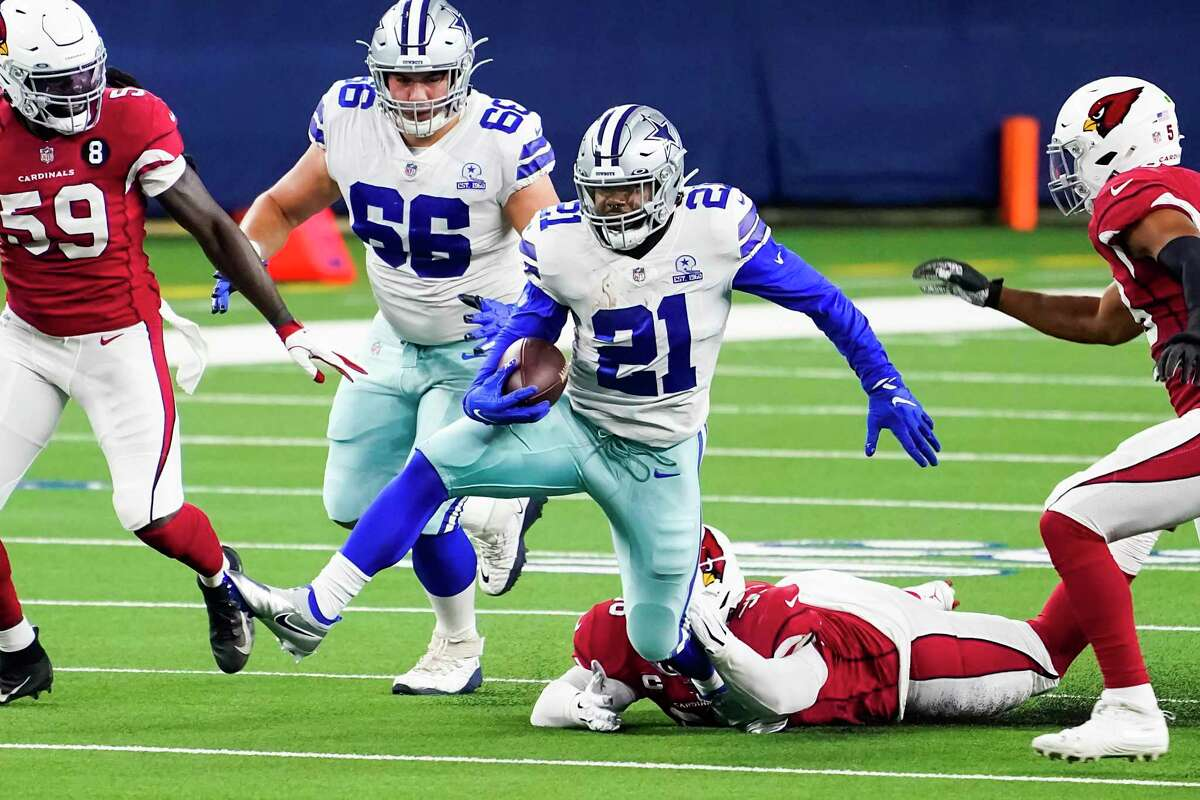 Dallas Cowboys running back Ezekiel Elliott breaks through the Arizona Cardinals on Oct. 19. That was pretty much the only highlight, but a reader says it's not Elliott's fault.