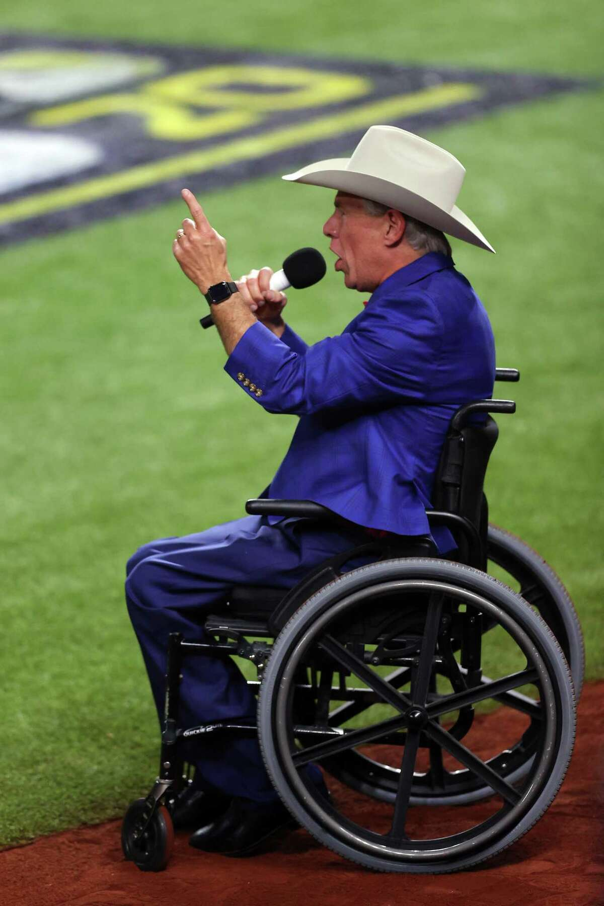 ARLINGTON, TEXAS - OCTOBER 20: Governor of Texas Greg Abbott ushers in the game by calling out the traditional