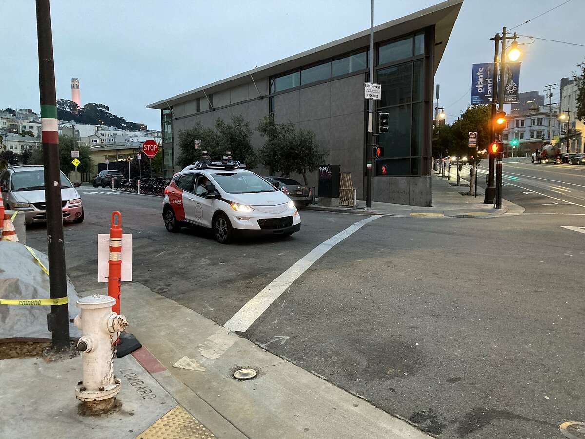 A Cruise self-driving vehicle travels past the North Beach Branch Library in the North Beach neighborhood on Oct. 8, 2020, in San Francisco, Calif.