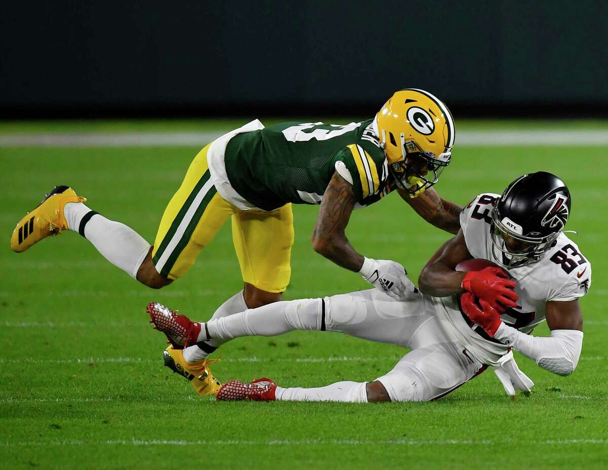 GREEN BAY, WISCONSIN - OCTOBER 05: Russell Gage #83 of the Atlanta Falcons is tackled in the first half by Jaire Alexander #23 of the Green Bay Packers at Lambeau Field on October 05, 2020 in Green Bay, Wisconsin.