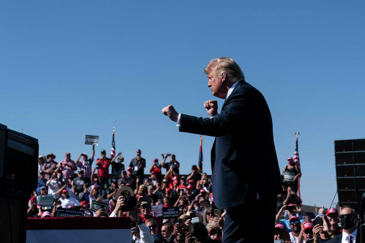 In this Oct. 19, 2020 photo, President Donald Trump dances to