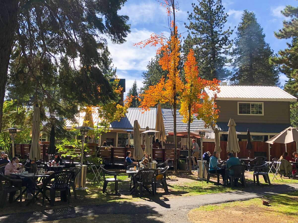 The restaurant put tables outside on the lawn, under tall pine trees and aspens.