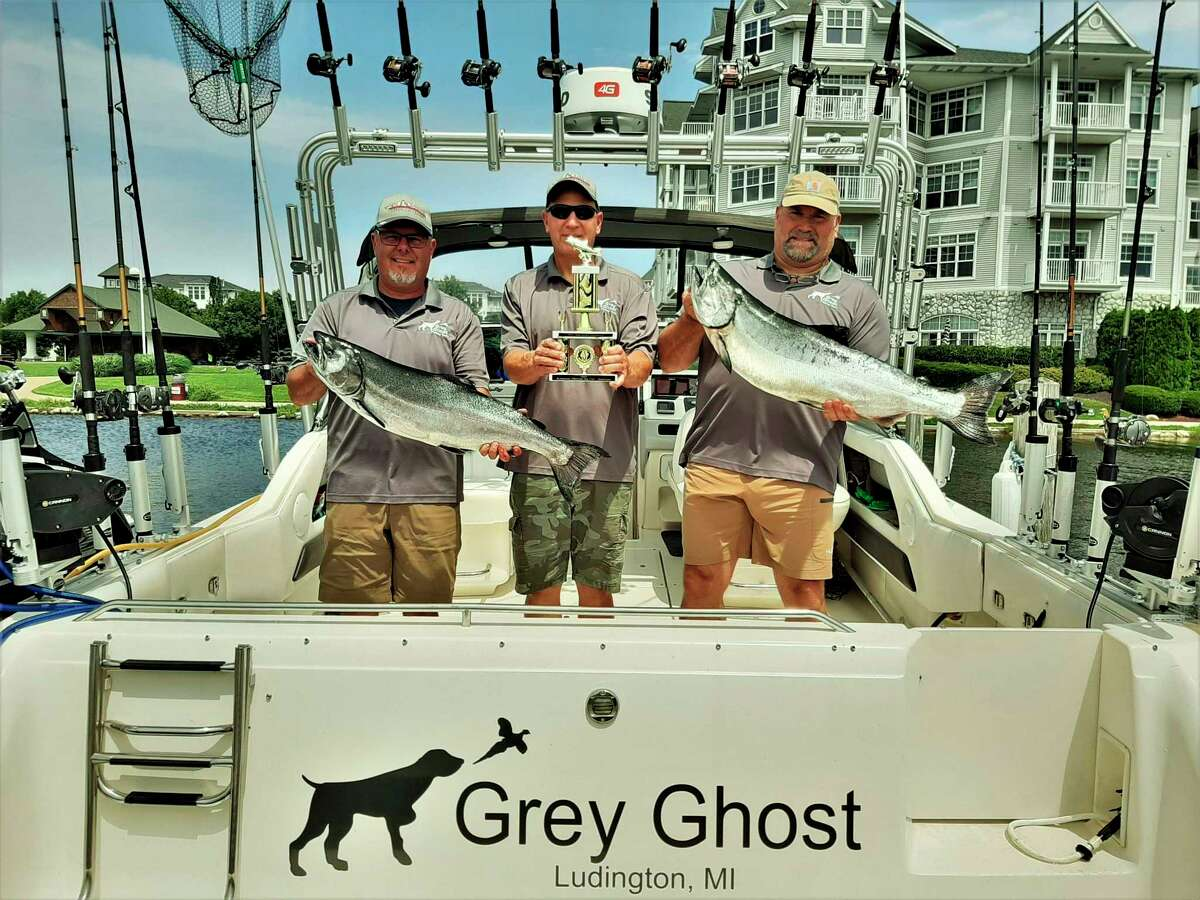 The Grey Ghost fishing teamgot the trophy for the largest steelhead in the Manistee County Sportfishing Association tournament this past summer. The steelhead ended up being the largest for the entire summer derby as well. Pictured are (from left) Robb Lott, Mark Sochocki of Evart, and Kevin Gosson. (Courtesy photo)