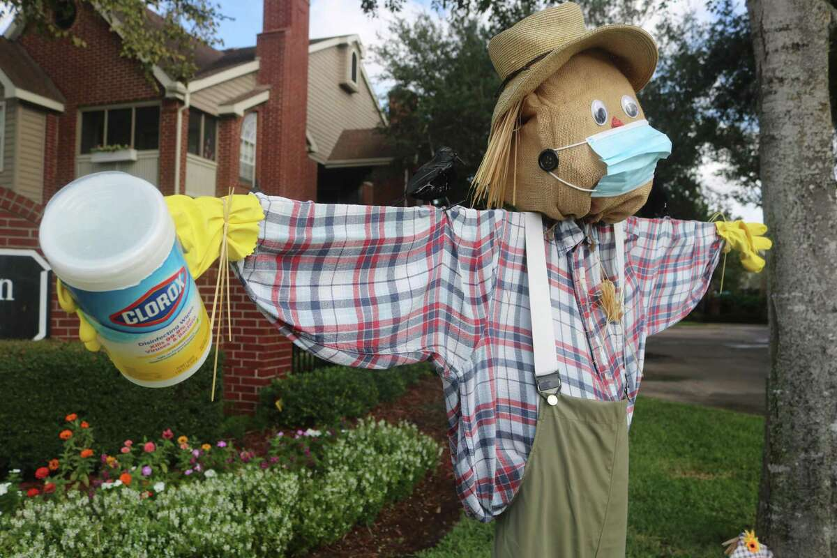 With buttons as ears, this scarecrow is helping his fellow scarecrows by wearing a face covering and keeping the sanitizing wipes nearby.
