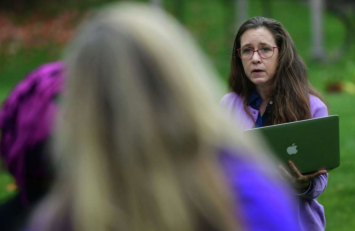 A family friend of Jennifer Dulos, Carrie Luft, gives her address as Connecticut Protective Moms hosts an awareness event for Domestic Violence Awareness Month at the Bush Holley House Historical Society Thursday, October 22, 2020, in Greenwich, Conn. The event focused on keeping the bill named after Jennifer Dulos, Jennifer's Law, alive.