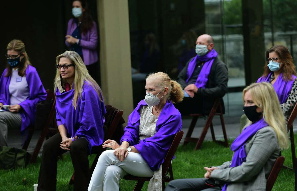 Members of Connecticut Protective Moms and others who support Jennifer's Law listen to lawmakers speak on the issue as Connecticut Protective Moms hosts an awareness event for Domestic Violence Awareness Month at the Bush Holley House Historical Society Thursday, October 22, 2020, in Greenwich, Conn. The event focused on keeping the bill named after Jennifer Dulos, Jennifer's Law, alive.