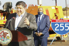 Standing on Interstate-255 Thursday, south of the I-64 interchange, Gov. J.B. Pritzker congratulates construction workers on completing the renovations and repaving of the interstate south to Illinois 15 ahead of schedule.