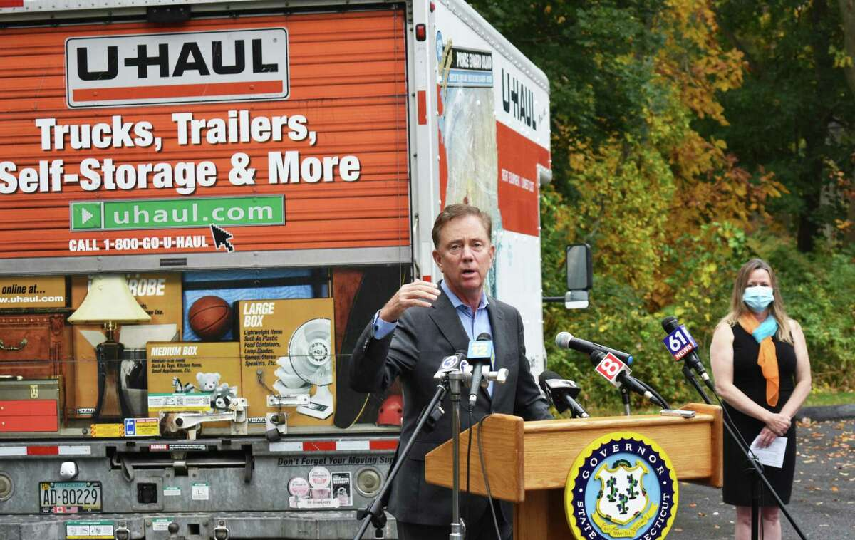 Against the backdrop of a moving truck iin Newtown, Conn. on Friday, Oct. 23, 2020, Gov. Ned Lamont touted Connecticut's renewed appeal for New York City dwellers pondering an escape to the suburbs, whether for a weekend home or on a permanent basis.
