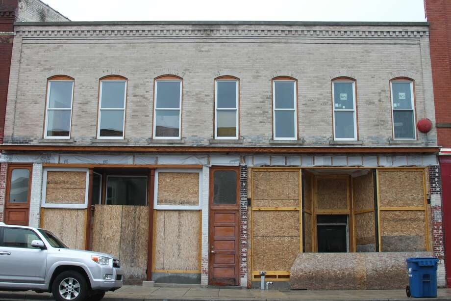 The owner of 347/349 River St. extended their building permit this year after receiving a letter from the Historic District Commission. The properties have been empty for over a decade. The City of Manistee's blight ordinance prohibits owning vacant or blighted structures; a new program was initiated in July to combat blight. Photo: Erin Glynn/Manistee News Advocate